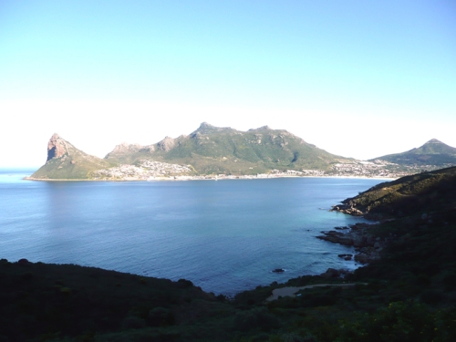 Morning sun on Chapman's Peak. The mountain in the distance looks like a rhino.