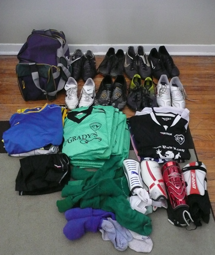 A set of (15) matching jerseys, (4) mismatched warm-up jerseys, (4) goalie jerseys, (7) pairs of cleats, (1) pair of turf shoes, (4) sets of shin guards, (3) pairs of shorts, (8) pairs of socks... and brand spanking new gym bag.